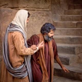 slijepac drži isusa